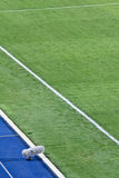 Microphone boom next to a field. A microphone boom next to a football field in a stadium in Vienna Stock Photo