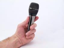 Microphone dans une main Photographie stock libre de droits