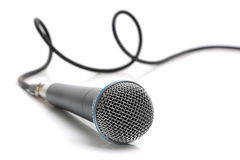 Microphone and cable. Microphone with a cable connected  on white Royalty Free Stock Image