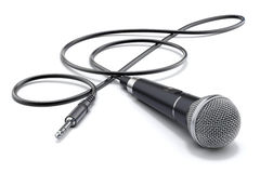 Microphone with the cable in form of treble clef and audio plug Royalty Free Stock Images