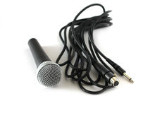 Microphone and cable over white Royalty Free Stock Images