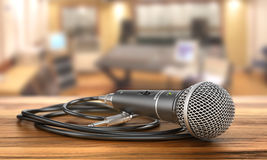 Microphone with cable on a studio background. Stock Photos
