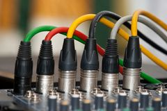 Microphone cables. Colored microphone cables connected to the sound mixer Royalty Free Stock Image