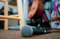 Microphone on carpeted floor with copy space. stock image