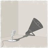 Microphone casting shadow of bullhorn Royalty Free Stock Photography