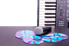 Microphone,cd discs and electronic keyboard Stock Photography