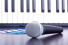 Microphone, cd disks and piano keyboard Royalty Free Stock Photography