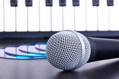 Microphone, cd disks and piano keyboard Stock Photos