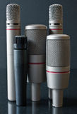 Microphone City. A selection of microphones standing together like a skyline Stock Images