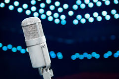 Microphone close up in concert hall Stock Images