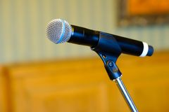 Microphone close up at the conference. Hall Royalty Free Stock Photography
