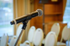Microphone close up at the conference. Hall Stock Photos