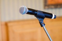Microphone close up at the conference. Hall Royalty Free Stock Images