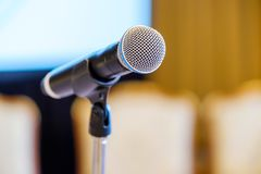 Microphone close up at the conference. Hall Stock Image