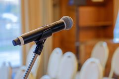 Microphone close up at the conference. Hall Stock Images