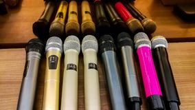 Microphone, Singing, Event, Singer, Spotlight. Microphone close up image.Karaoke and music background.Microphone detail stock photography