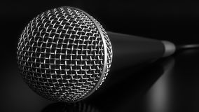 Microphone against black background. 3D rendering royalty free stock photography