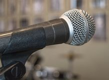Microphone close-up, used by speaker to speak in conference room, seminar, University, lectures, blurred background.  royalty free stock image