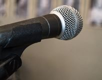 Microphone close-up, used by speaker to speak in conference room, seminar, University, lectures, blurred background.  stock image