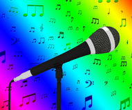 Microphone Closeup With Musical Notes Shows Songs Or Hits. Microphone Closeup With Musical Notes Showing Songs Or Musical Hits Stock Image