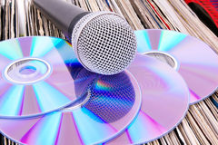 Microphone and compact disks on records Stock Photography