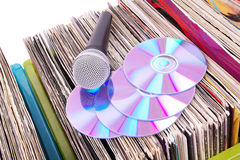 Microphone and compact disks on records Stock Image