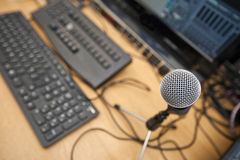 Microphone and computer keyboards on table at television studio Stock Image