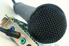 Microphone and computer sound card. Studio microphone and computer sound card close-up stock photo