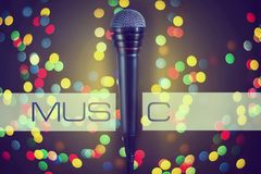 Microphone. Concept music, concert, karaoke, poster. Copy space. Microphone. Concept music, concert, karaoke, poster Copy space Dark background bokeh Stock Image