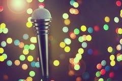 Microphone. Concept music, concert, karaoke, poster. Copy space. Microphone. Concept music, concert, karaoke, poster Copy space Dark background bokeh Royalty Free Stock Image