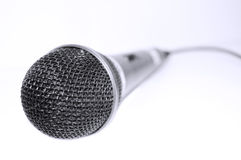 Microphone conceptual image. Approximation of isolated microphone Stock Photo