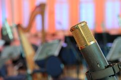 Microphone in a concert hall. Royalty Free Stock Photo