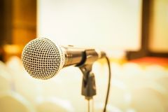 Microphone in concert hall or conference room . Left side Royalty Free Stock Photos