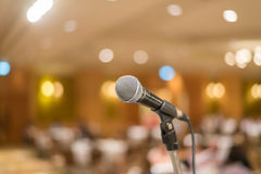 Microphone in concert hall or conference room with lights in background. with extremely shallow dof.  royalty free stock photos