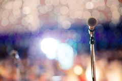 . Microphone in concert hall or conference room soft and blur style for background.Microphone over the Abstract blurred photo of conference hall or seminar room Royalty Free Stock Photo