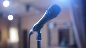 Microphone In Concert Hall. Stage lighting, equipment and microphone stand in a night club stock footage