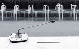 Microphone in conference room Stock Images