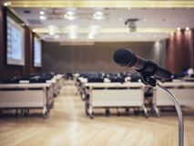 Microphone in Conference Seminar room Event Background Royalty Free Stock Image