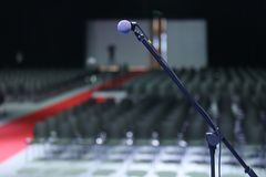 Microphone in Conference Seminar room Event Background Royalty Free Stock Images