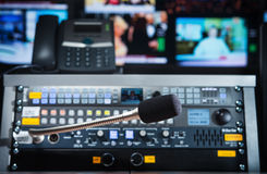 Microphone on the control panel in the media studio. The control panel for the operator with a microphone in the newsroom Stock Photo