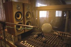 The microphone in the control room audio system of organizations and companies. Vintage audio recording equipment, sound mixer, on the board in the studio stock photo