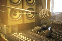 The microphone in the control room audio system of organizations and companies. Vintage audio recording equipment, sound mixer, on the board in the studio stock image