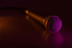 Microphone with cord. Vocal mike with cord in a color light royalty free stock photo