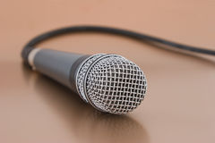 Microphone with cord. Close-up of vocal mike with cord Stock Photo