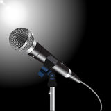 Microphone cord vector. Microphone with a cord on a Spotlight background Stock Photos
