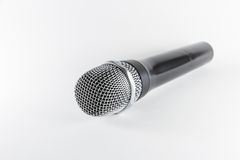 Microphone d'isolement sur le fond blanc Photo stock