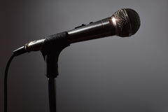 Microphone in the dark with gray background Stock Photo