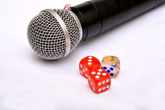 Microphone with dice - Motivational Speaker Stock Images