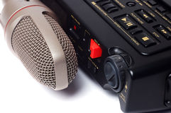 Microphone and dictophone. On a white background royalty free stock image