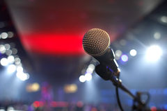 Microphone in a disco. Closeup concert microphone with disco lights